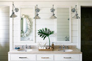 A modern bathroom with a whimsical shell chandelier