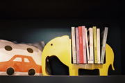 Shelf styling with kid-friendly accessories and books