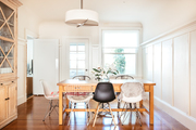 A contemporary dining room with a farmhouse dining table.