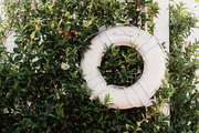 A life preserver hung on a fence of vines