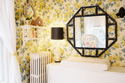 Floral yellow wallpaper paired with a modern white console
