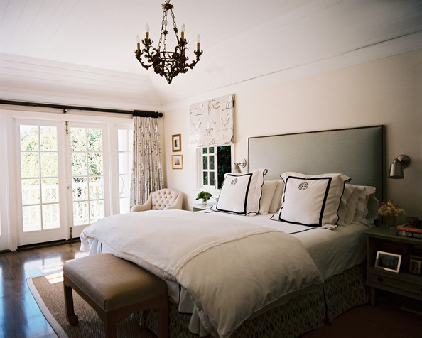 January February 2011 Issue - A gray upholstered headboard with white-and-black monogrammed linens