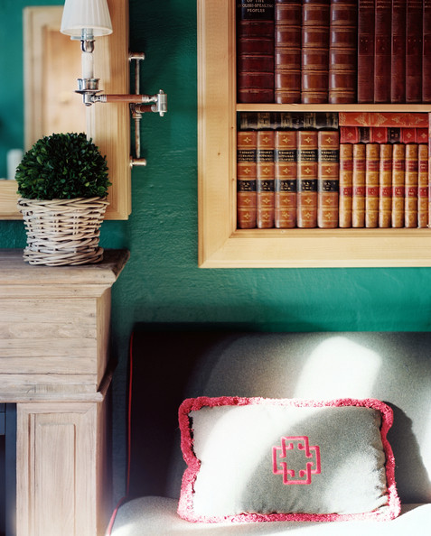 January February 2013 Issue - Shelves of books beside a wooden mantel