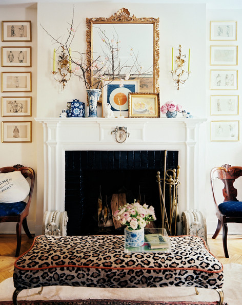 January February 2013 Issue - A leopard-print ottoman and wooden occasional chairs surrounding a white mantel