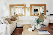 A white sectional in a neutral living room