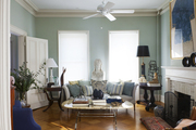 A living room filled with antique furniture and vintage artwork and decor