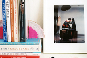 Bookshelves styled with framed photos and accessories