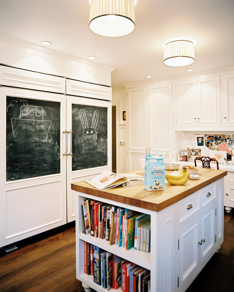 Kitchen - A kitchen with chalkboard panels on white refrigerator doors