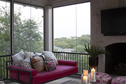 Pink hanging bench in outdoor porch.