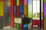 Stained-glass sliding doors separating kitchen and bath in a Paris apartment
