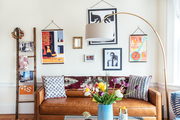 A contemporary living space with boho accents.