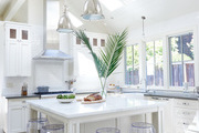 A modern farmhouse kitchen with transparent stools.