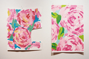 Colorful floral artwork against a white wall