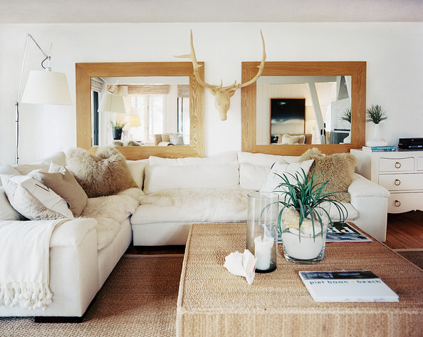 Living Room Bohemian - A white sectional in a neutral living room