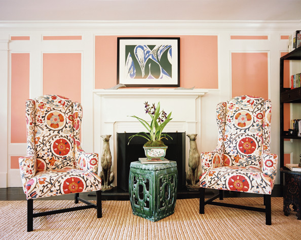 Living Room - Pink paneled walls and a pair of floral wingback chairs with a garden stool