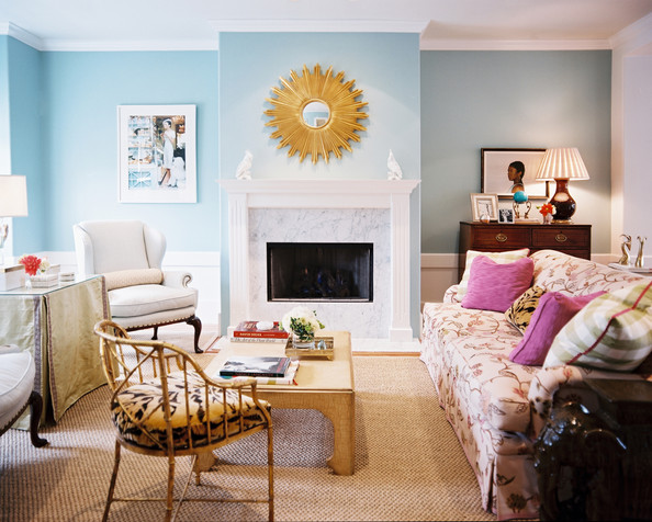 Living Room - A floral couch, a pair of white wingback chairs, and a tiger-print occasional chair in a blue living room