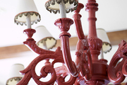 A painted red chandelier updated with lace trim