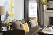 Yellow flowers brighten up a fireplace mantel