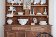 A rustic hutch and a collection of antique milk glass