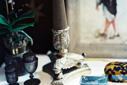 Decorative accessories and a potted plant on a white tabletop