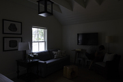 White living room lit by small window.