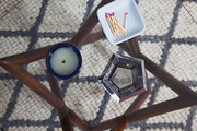 Eclectic tabletop items on a midcentury coffee table