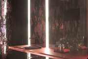 A sleek bathroom with pink accents