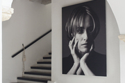A portrait of designer and hotelier Silvia Tcherassi hangs in the entryway of her namesake hotel and spa.