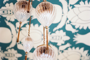 A delicate glass-and-gold chandelier