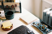 Framed photos and office essentials on a marble desk surface
