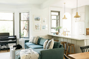 A contemporary living space witha . blue sofa and white walls.