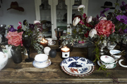 A Kentucky Derby party table is set with fine china and silver