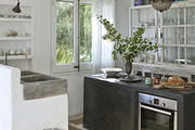 The custom concrete kitchen of artist Pepa Poch's home and studio.