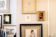 A collection of framed art hung in an entryway