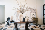 Geometric floors and a gathering of white busts and sculptures