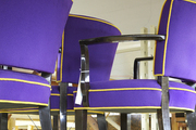 Regal purple chairs waiting to be auctioned off
