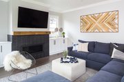 A contemporary living space with a navy sofa.