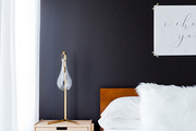 A contemporary bedroom with a black wall.