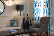 Patterned curtains paired with neutral furnishings