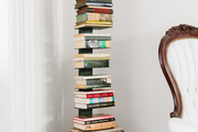 A stack of books in the corner of a space.