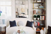 A white settee paired with a footstool