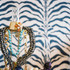 Jewelry on display in front of zebra-print wallpaper