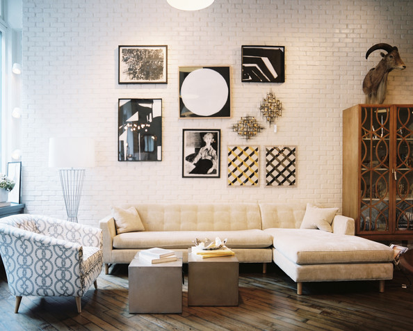 Painted Brick - An art grouping above a beige sectional