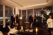 Guests mingling at an elegant holiday dinner party