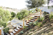 An edible garden with tiered beds of cold-season crops