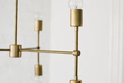 Contemporary gold light fixture.