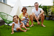 Poppy, Irene, Rhys, and Jason Edwards on their rooftop patio