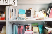 Books and pamphlets arranged on white shelves