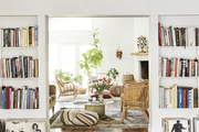 A bright living space with built-in book shelves.
