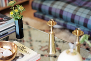 Brass accessories atop a glass coffee table